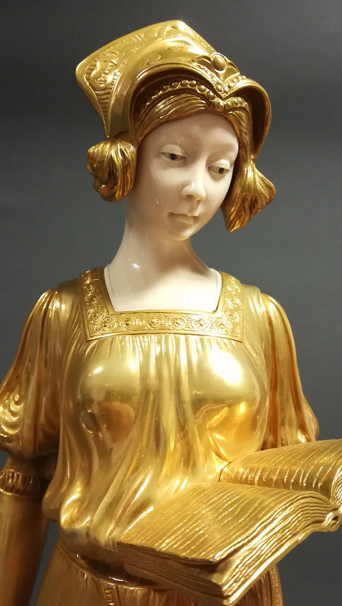 Medieval Lady, Chryselephantine sculpture in gilded bronze with ivory and staggered pedestal onyx